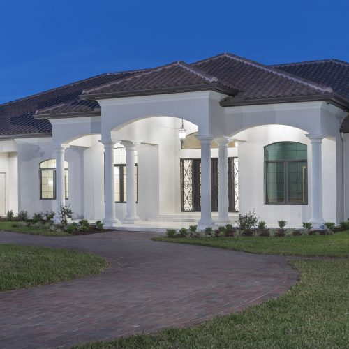 frontside exterior shot of new custom traditional home by Beck Custom Homes