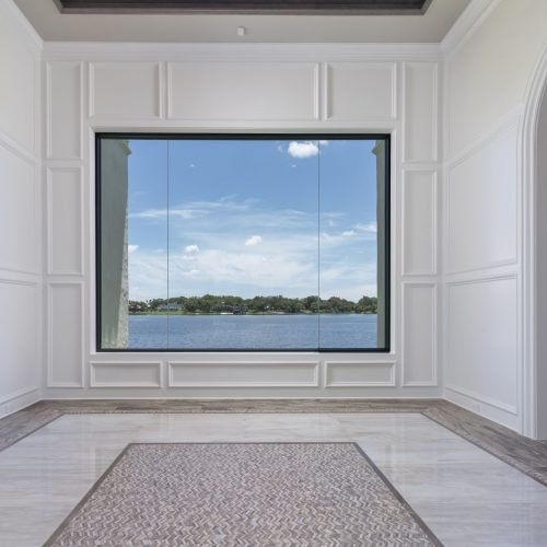 interior of custom transitional style home with lakefront view