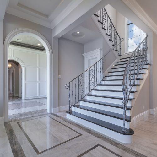 custom staircase design at new home by Beck Custom Homes